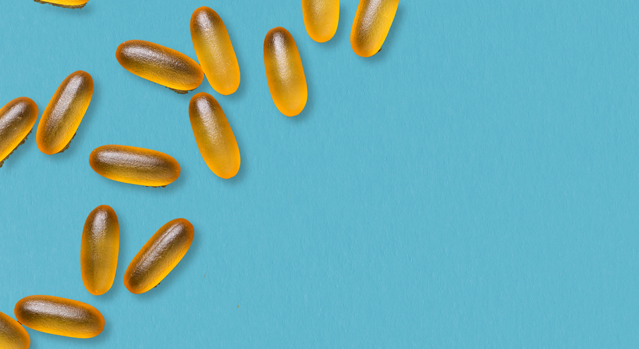 Yellow pill capsules on a blue background