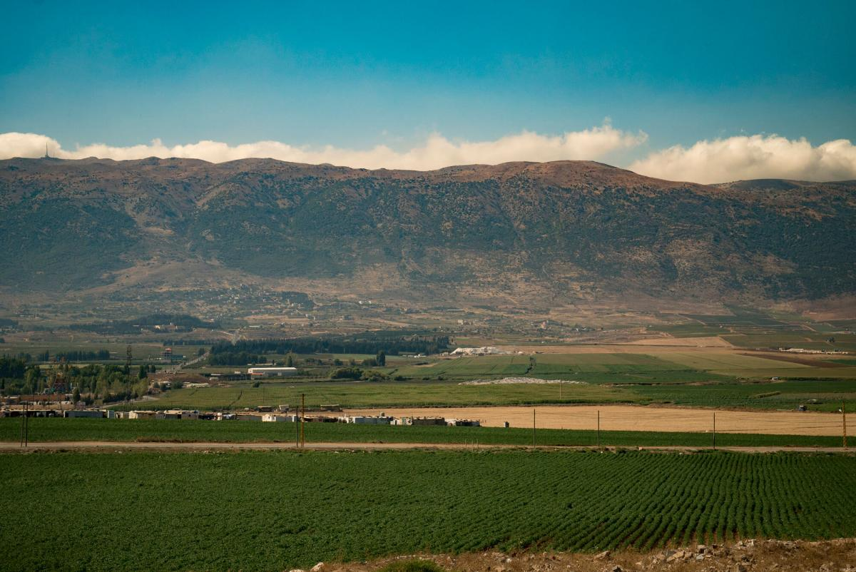 A refugee camp sits among agriculture fields in the Bekaa Valley, Lebanon.