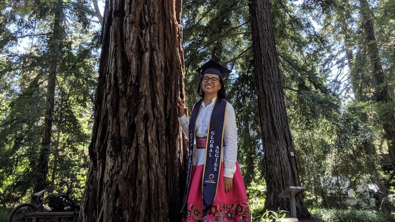 Maria Arteaga standing in front of a redwood tree