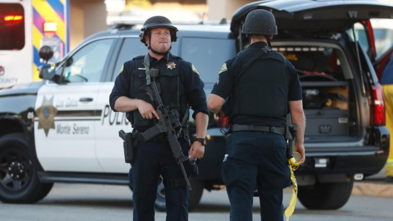 Police stand guard outside of Gilroy High School outside of the Gilroy Garlic Festival following a shooting in Gilroy, Calif., on Sunday, July 28, 2019. (Nhat V. Meyer/Bay Area News Group)