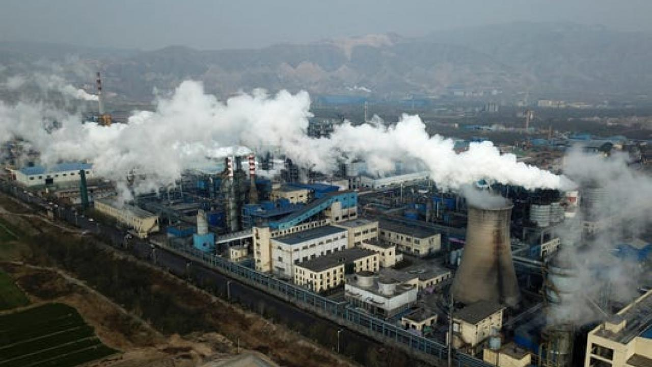 In this Nov. 28, 2019, file photo, smoke and steam rise from a coal processing plant in Hejin in central China's Shanxi Province
