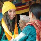 A UC Davis student at a New Year's ceremony at a monastery in Pokhara.