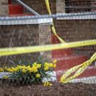 An evidence marker next to daffodils at the scene where Sylvia Hardy's grandson, 15, was shot and killed on South Kilbourn Avenue, April 8, 2020, in the Lawndale neighborhood of Chicago. (Erin Hooley / Chicago Tribune)