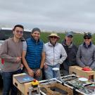 Vougioukas with lab members and the strawberry harvest-aid FRAIL-bot. (Stavros Vougioukas/UC Davis)